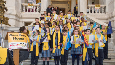 singing at state house on stairs